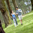 Couple running at the park — Stock Photo