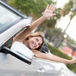 Happy woman in her new car — Stock Photo