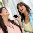 Stock Photo: Happy women on phone