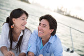 Happy couple sailing — Stock Photo