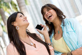 Happy women on the phone — Stock Photo