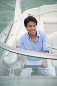 Man driving a boat — Stock Photo