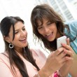Stock Photo: Women using app on a cell phone