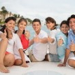 Happy friends with thumbs up — Stock Photo #24756453
