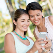 Girls using app on a mobile phone — Stock Photo
