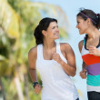 Sports women running outdoors — Stock Photo