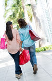 Female shoppers walking outdoors — Stock Photo