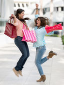 Excited shopping women — 图库照片