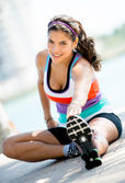 Athletic woman stretching outdoors — Stock Photo