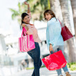 Excited shopping girls — Stock Photo