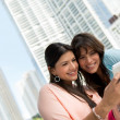 Stock Photo: Women using smart phone