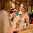Girl friends having drinks — Stock Photo