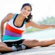 Woman stretching outdoors — Stock Photo #24848307