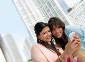Women using a smart phone — Stockfoto