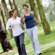 Women running outdoors — Stock Photo #24883019
