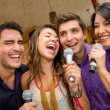Foto Stock: Friends karaoke singing