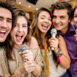Group of friends singing — Stock Photo