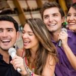 Group of karaoke signing — Stock Photo