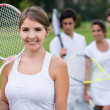 Female tennis player with her team — Stock Photo