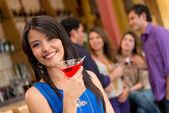 Woman at the bar — Stock Photo