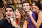 Group of karaoke signing — Stock Photo