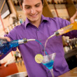 Barman making cocktail - Stock Photo