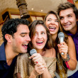Stock Photo: Friends karaoke singing