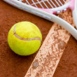 Tennis racket with a ball - Stock Photo