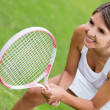 Womplaying tennis — Stock Photo #24994145