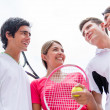 Group of tennis players talking — Stock Photo