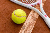Tennis racket with a ball — Stock Photo