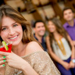 Woman having a cocktail - Stock Photo
