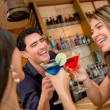 Group of friends at the bar — Stock Photo