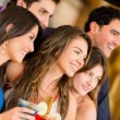 Group of friends at the bar — Stock Photo #25038803