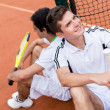 Tennis players at the court — Stock Photo