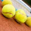 Tennis balls with racket — Stock Photo