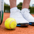 Tennis player at the court - Stock Photo