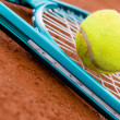 Tennis racket with a ball — Stock Photo #25039227