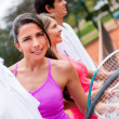 Tennis player with a group — Stock Photo