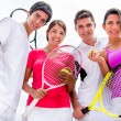 Foto Stock: Friends playing tennis