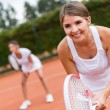 Tennis players playing doubles — Stock Photo