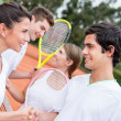 Tennis players handshaking - Stock Photo