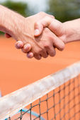 Handshake at a tennis match — Stock Photo