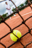Tennis player playing a match — Stockfoto