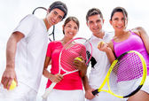 Friends playing tennis — Stock Photo