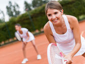 Tennis players playing doubles — Stok fotoğraf