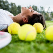 Tennis player daydreaming outdoors - Stock Photo