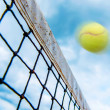 Tennis ball over the net - Stock Photo