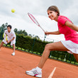 Woman playing doubles in tennis — Stock Photo #25082959