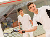 Men playing squash — Stock Photo